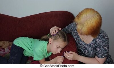 Mom comforts her daughter