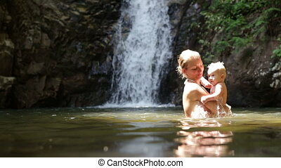 mom dive baby waterfall
