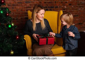 Mom gives a child Christmas gift