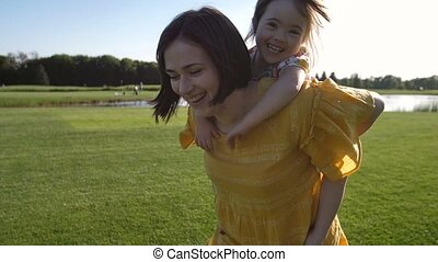 Mom giving piggyback ride to special daughter