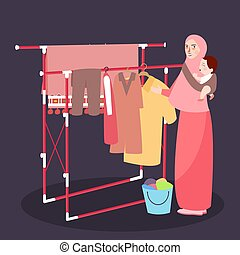 Mom hanging clothes on the line wearing veil while bring baby