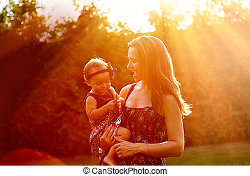 Mom holds daughter on the hands