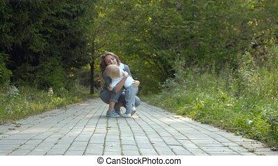 Mom hugging her baby boy