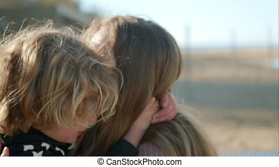 Mom hugs her son