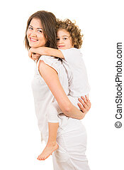 Mom offering piggyback ride to her daughter - Happy mother...