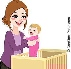 Mom Picking Baby From Crib - Beautiful young mom picking...