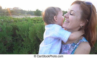mom playing with young son laugh happiness