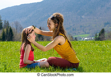 Mom plays with her daughter in a field