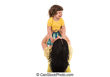 Mother raise her son over her head isolated on whie background