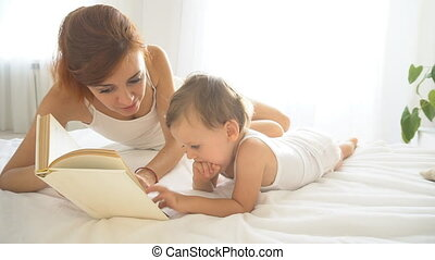 mom reads little son a book at bedtime