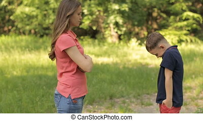 Mom scolds her son in the park