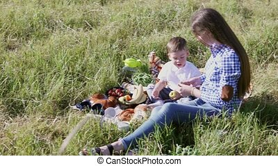 mom son eat at a picnic in the forest 1