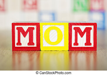 Mom Spelled Out in Alphabet Building Blocks