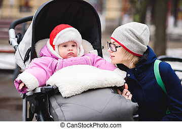 Mom talking with baby in the park