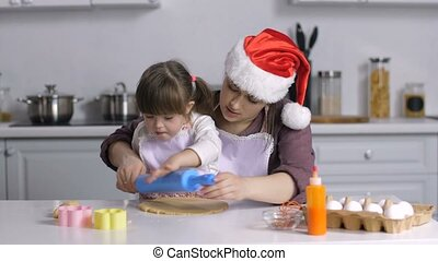 Mom teaching special needs kid to roll out dough