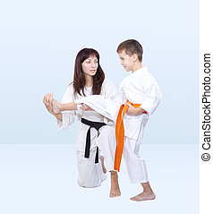 Mom the coach teaches son is beat kick leg