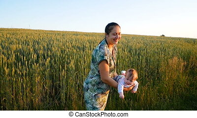 Mom throws up and catches her little daughter In the wheat...
