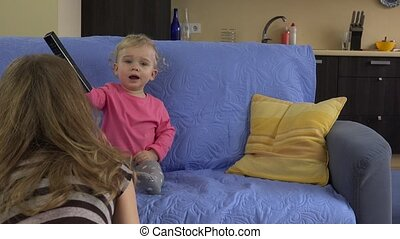 Mom try interrupt baby daughter girl watching television
