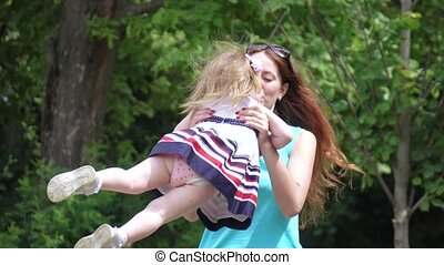 Mom turns the baby in her arms