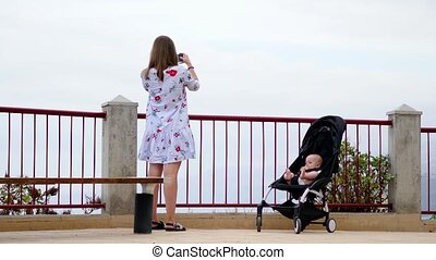 Mom with a baby in a wheelchair on the observation deck...