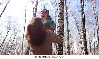 Mom with a child having fun playing