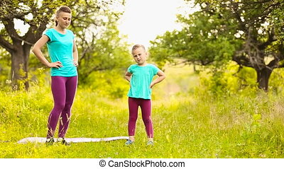 Mom with a child involved in fitness