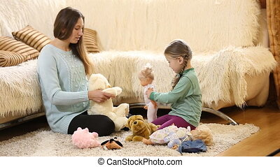Mom with a child playing with dolls