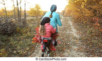 Mom with a child to ride a bicycle
