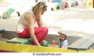 Mom with baby sandbox