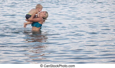 Mom with baby swimming