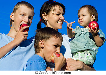 mom with children and apples