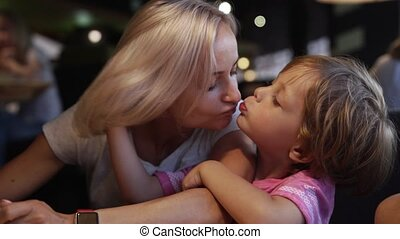 mom with children chooses pizza in a cafe and have a fun -...