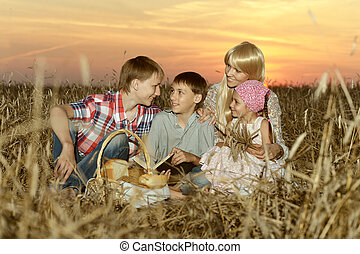 Mom with children on wheat field