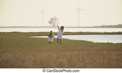 mom with daughter and balloons walk