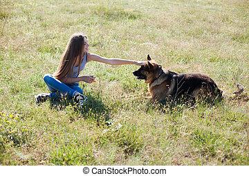 Mom with dog German Shepherd on a walk