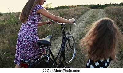 Mom with her daughter and the bike