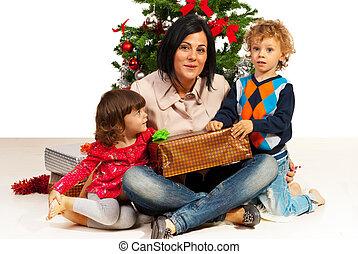 Mom with kids celebrate Christmas