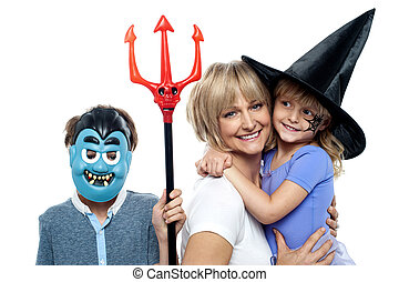 Mom with son and daughter. Halloween dress up.