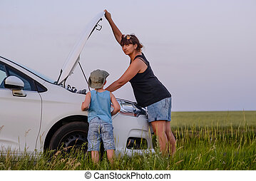 Mom with Son Opening the Front of Defective Car