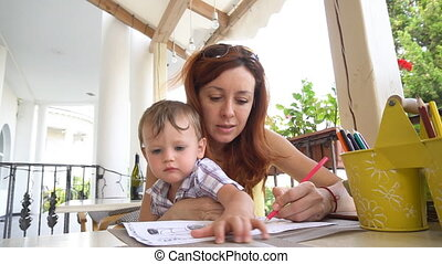 mom with son use a smartphone for Internet access