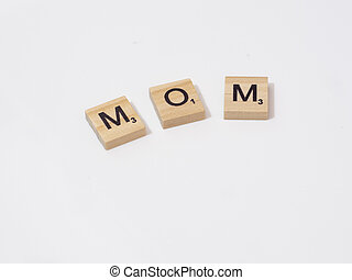 Mom word written with wooden blocks isolated