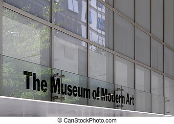 MoMA Museum of Modern Art, Facade. New York City. The building is design by famous Japanese architect Yoshio Taniguchi and MoMA collection has grown to include over 150,000 art pieces and design objects. It is the most influential museum of modern art in the world.
