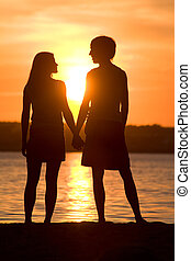 Moment of love - Rear view of romantic couple looking at...