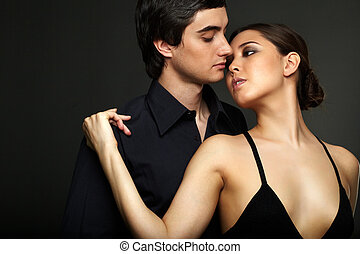 Moment of passion - Portrait of elegant girl with handsome...