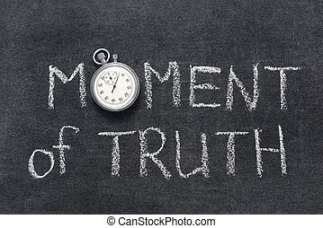 moment of truth phrase handwritten on chalkboard with vintage precise stopwatch used instead of O
