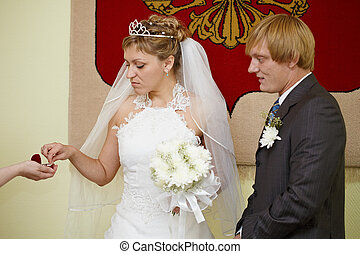 Moment of wearing of wedding rings - The moment of wearing...