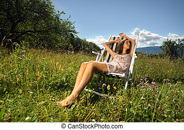 moments of pure relaxation - a pretty girl sleeping on a...