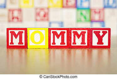 Mommy Spelled Out in Alphabet Building Blocks