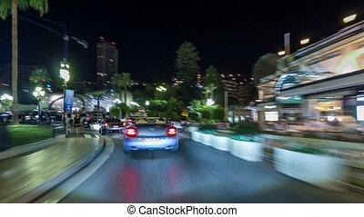 monaco, cidade, estradas, tráfego, à noite, com, luz carro,...