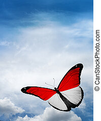 Monaco, Indonesia flag butterfly flying on sky background